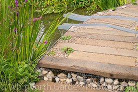 The WWT Working Wetlands Garden supported by the HSBC Water Programme at the RHS Hampton Court Flower Show 2016. Designer: Je...