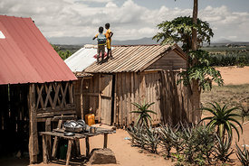 Schoolchildren from Ankileisoke Primary School play on the roof of a wooden house before having lunch in the South Amboasary ...