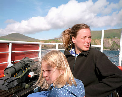 Mother and daughter riding on ferry boat