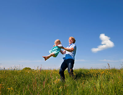 Father and daughter playing in field