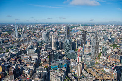 Aerial view of the City of London, Square Mile, Financial District showing Swiss Re Tower, 20 Fenchurch St, The Leadenhall Building and the Hewron Tower, with the River Thames and Westminster in the far background. London aerial view.