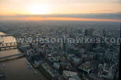 Aerial view of the Thames river and the financial district of the City of London, London