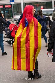 A protestor walks with the Catalonia secession flag at the protests on La Rambla in Barcelona, Spain