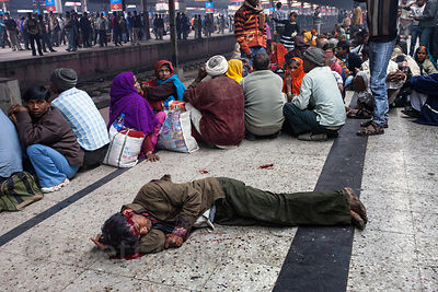 A man lies bleeding on the Sealdah railway station platform in Kolkata, India. He remained there for about an hour before an ...
