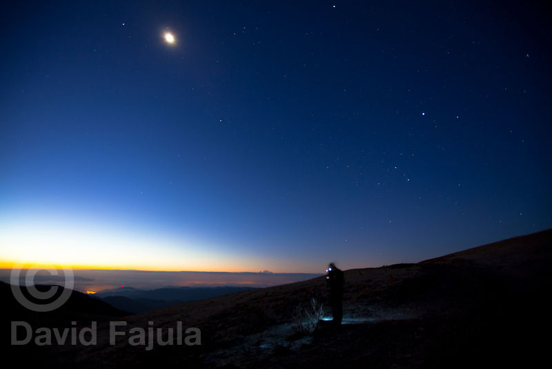 Photographer with head torch at dawn, on the east edge of the Cadí & Moixeró Natural Park (Coll de la Creueta, 1888 masl)