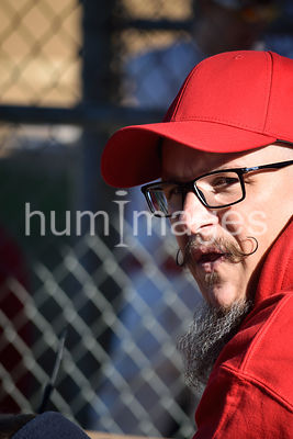 Man with handlebar mustache and glasses looking at camera