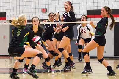 Linn-Mar players react to a missed volley versus Dubuque Hempstead at the 2012 Linn-Mar Varsity Volleyball Tourney Saturday, ...