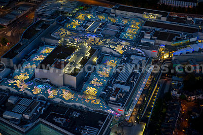 Aerial view over Westfield at night, Shepherd's Bush, London