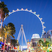 "Tourist walking down shopping street with giant ferris wheel called ""High Roller"", Las Vegas, Nevada, USA"