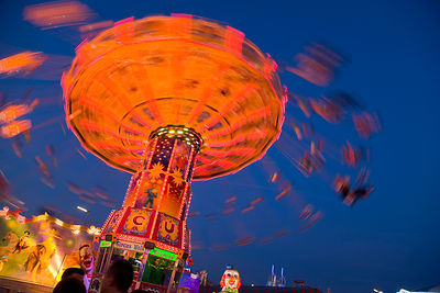 Germany, Munich, View of moving carousel at oktoberfest in night