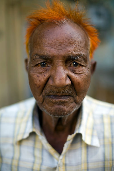 India - Jaipur - An old man with his hair dyed with henna