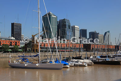 Puerto Madero docklands regeneration in Buenos Aires, Argentina, with high-rise buildings, old warehouses, and yachts in the ...
