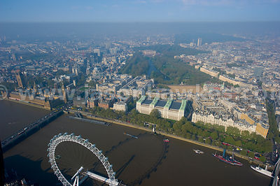 Aerial view over Houses of Parliament with London Eye In Foreground, London