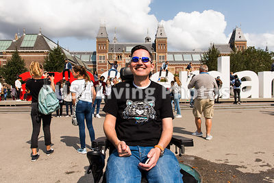 A man using a power wheelchair exploring Amsterdam