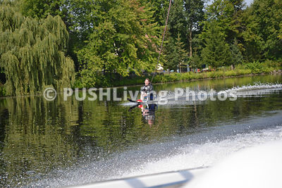 Man waterskiing on a lake with a sit ski