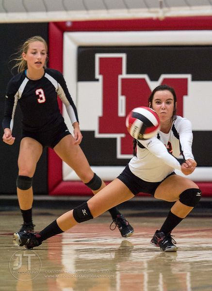Linn-Mar's Kiley Coppock (22) returns a volley versus Dubuque Hempstead at the 2012 Linn-Mar Varsity Volleyball Tourney Satur...