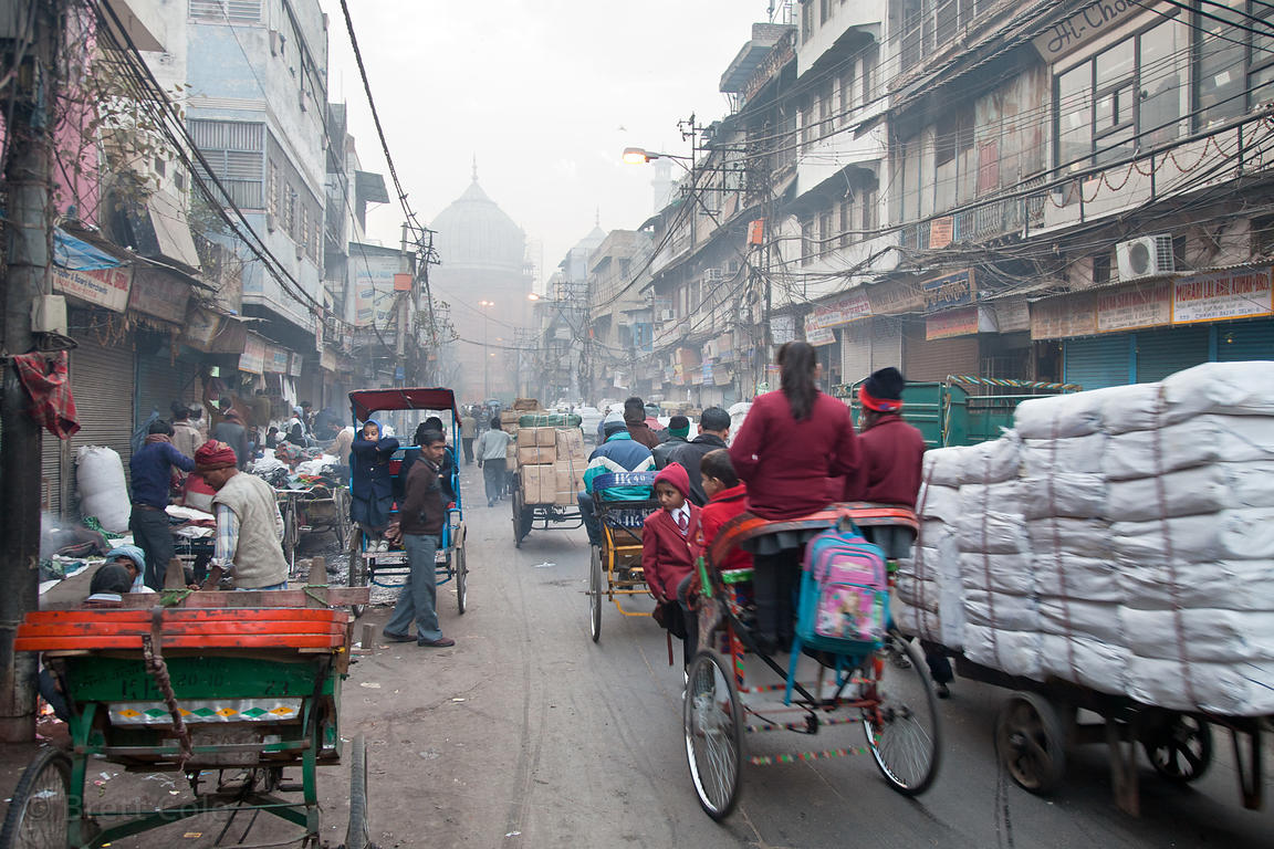 Children are driven to school in auto rickshaws in the Chandi Chowk area of Old Delhi, India