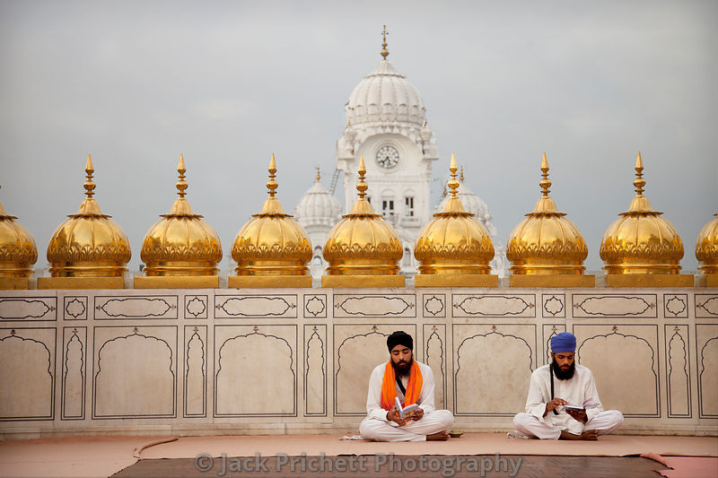Two young Sikh men study holy texts at the Golden Temple.