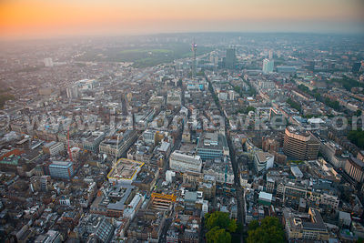 Aerial view looking North up Rathbone Street towards the BT tower at dusk, London