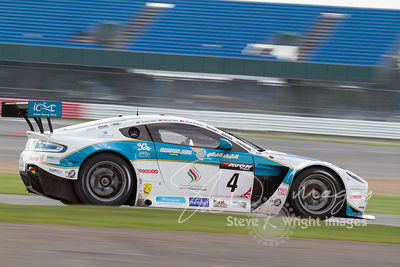 Ahmad Al Harthy and Michael Caine's race-winning Oman Racing Team Aston Martin Vantage GT3. In action at the Silverstone 500 ...