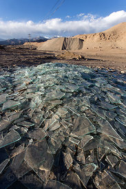 Broken glass litters the desert near Karu, Ladakh, India