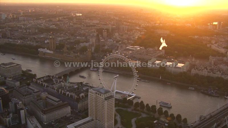 Aerial footage of the London Eye and Westminster at sunset, London