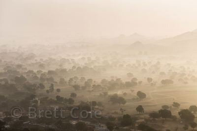 Hazy winter morning over farmland and rural village of Hokaran, from the Bedhnath temple area, Pushkar, Rajasthan, India