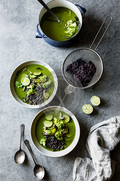 Green thai vegetable soup with cilantro and black rice noodles