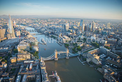 Aerial view of Tower Bridge, City of London at dawn.