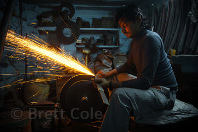 A swordsmith sharpening blades, Jodhpur, Rajasthan, India