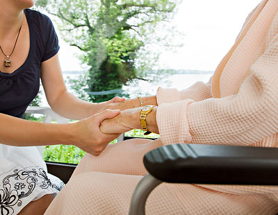 woman and senior woman holding hands