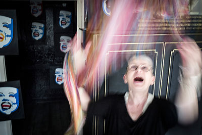 Manic phases are one of the hallmarks of bipolar disorder. During the course of a year-long project about the disease, I shot in many different situations and with a good number of patients. The woman on this picture told me that manic phases induce in her an irrepressible urge to paint and to create. She loses sleep, creates and paints, unhindered, and without any perceivable constraints as the brush runs over the canvas. She described it as a very pleasant moment and is very proud that the disease unlocked her creative potential as a painter. She poses here with some of her paintings. - Geneva, Switzerland, 29 March 2018