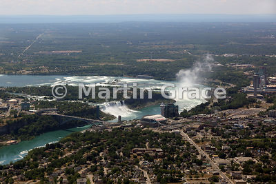 Niagara Falls from the air, looking over the Canadian town to Rainbow Bridge; American and Bridal Veil Falls (USA); Goat Isla...
