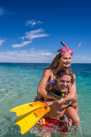 Couple having fun on the water off Ninglaoo Reef , Western Australia