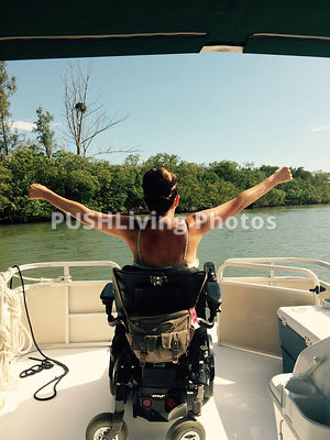 Young woman using a power wheelchair on a boat
