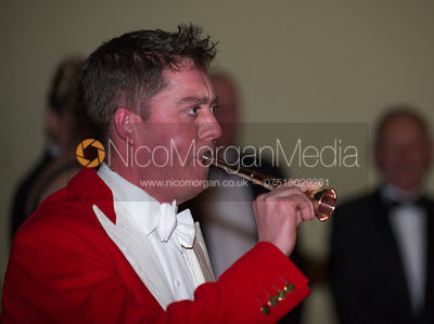 Man blowing a hunting horn