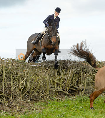 Annabel Bealby jumping a hedge near Gartree Covert