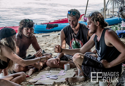 Playing Rock Paper Scissors And Cards On A Tropical Beach