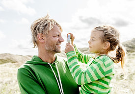 Danish father holding his daughter in the dunes in Thy