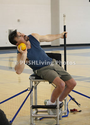 Disabled athelete throwing a shot put