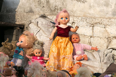 A collection of dolls on a stoop in Pushkar, Rajasthan, India