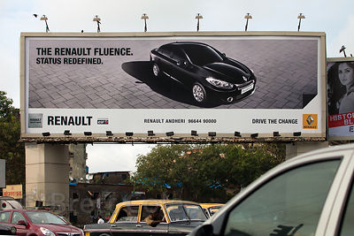 A billboard in Mumbai, India for a Renault luxury car, pushing status, which is a common theme of advertising in India's big ...