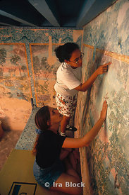 Conservators work carefully on murals, Cuba