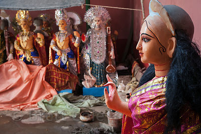 Durga Puja idols are painted and dressed at a workshop in Kumartoli (Potter's Town), Kolkata, India.