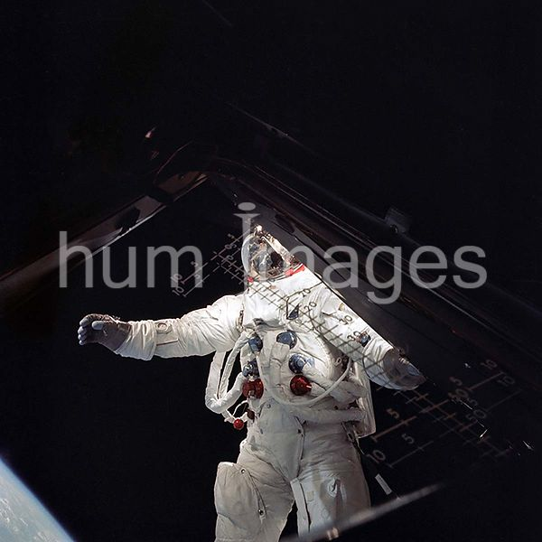 6 March 1969 - Astronaut Russell L. Schweickart, stands in golden slippers on the Lunar Module porch during his extravehicula...