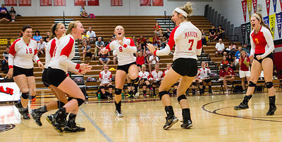 Marion players celebrate a point scored at the 2012 Linn-Mar Varsity Volleyball Tourney Saturday, September 8, 2012. (Justin ...