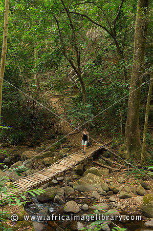 Hiker crossing the Sanje River, Udzungwa Mountains National Park, Tanzania