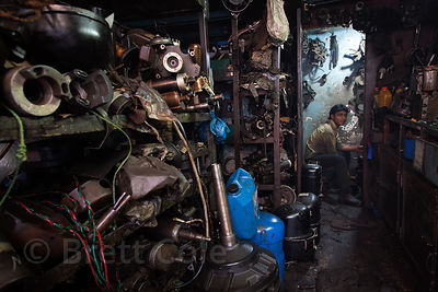 A machinist works at a shop in the Dharavi slum, Mumbai, India.