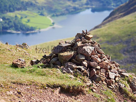 A route Cairn, pile of stones, near the summit of Red Pike in the English Lake District, UK.