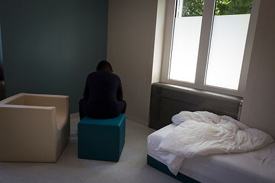 A patient prostrated in the room for intensive care, designed so that they can regain control over their emotions and behaviors in a safe environment, devoid of any kind of danger. Nyon, Switzerland, 20 June 2018
